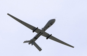 about lethal drones - looking up at a lethal drone flying overhead.
